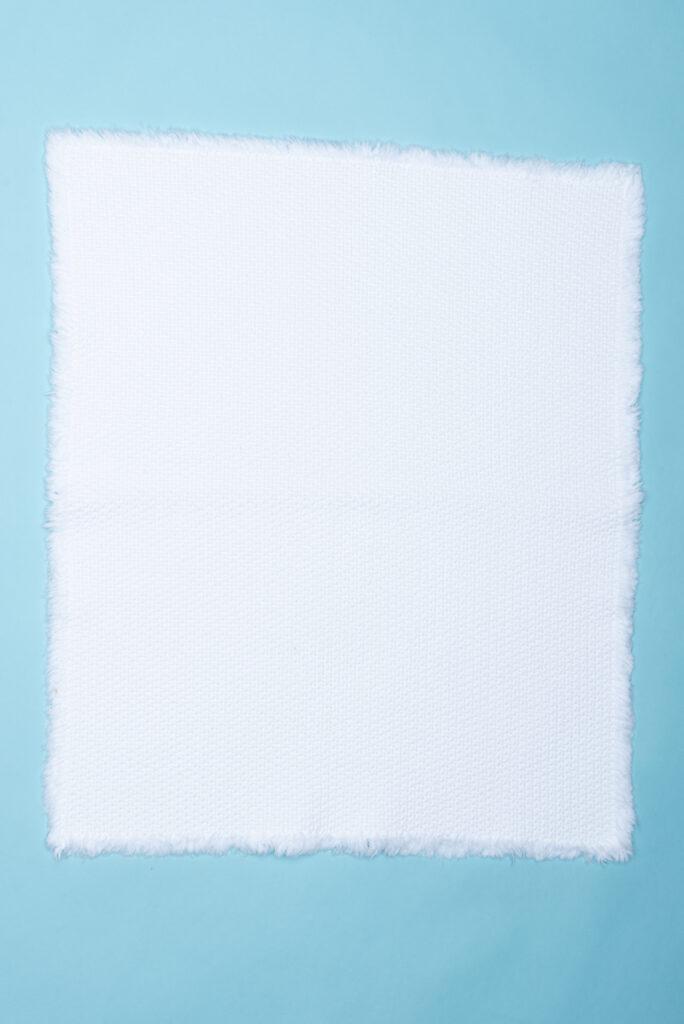 Dovi Details | tappeto bagno in cotone bianco intrecciato